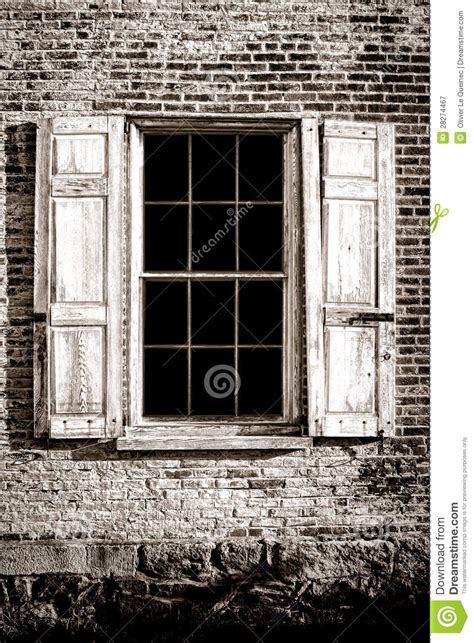 Old Window And Wood Shutters On Ancient Brick Wall Royalty